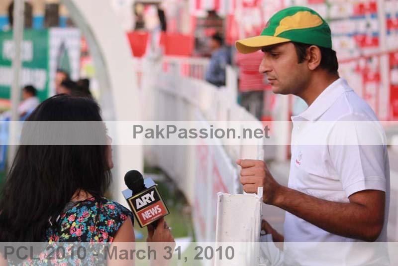 Faisal Iqbal speaks with a reporter