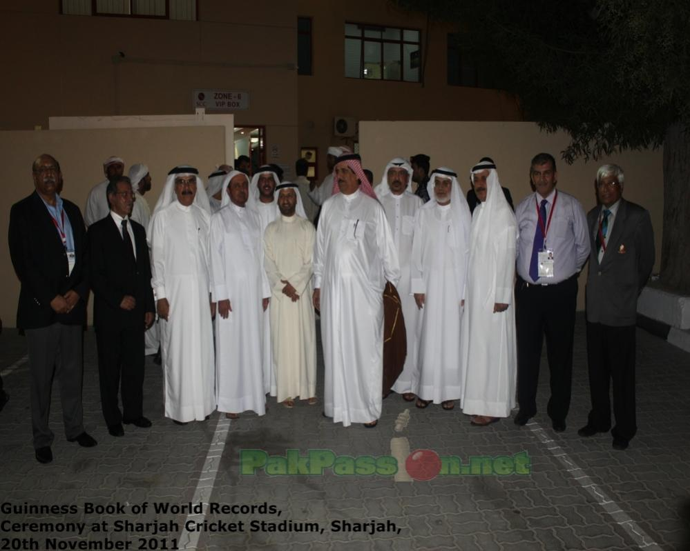 Dignitaries standing outside the VIP entrance