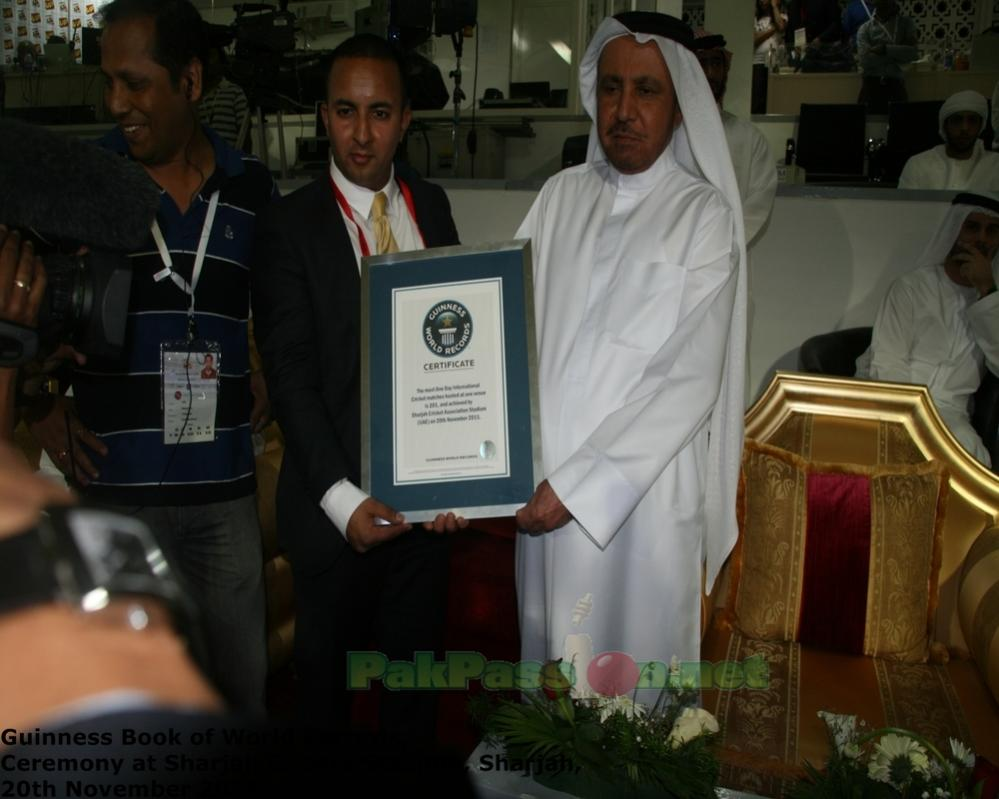 Guinness Book of World Records Official giving a certificate