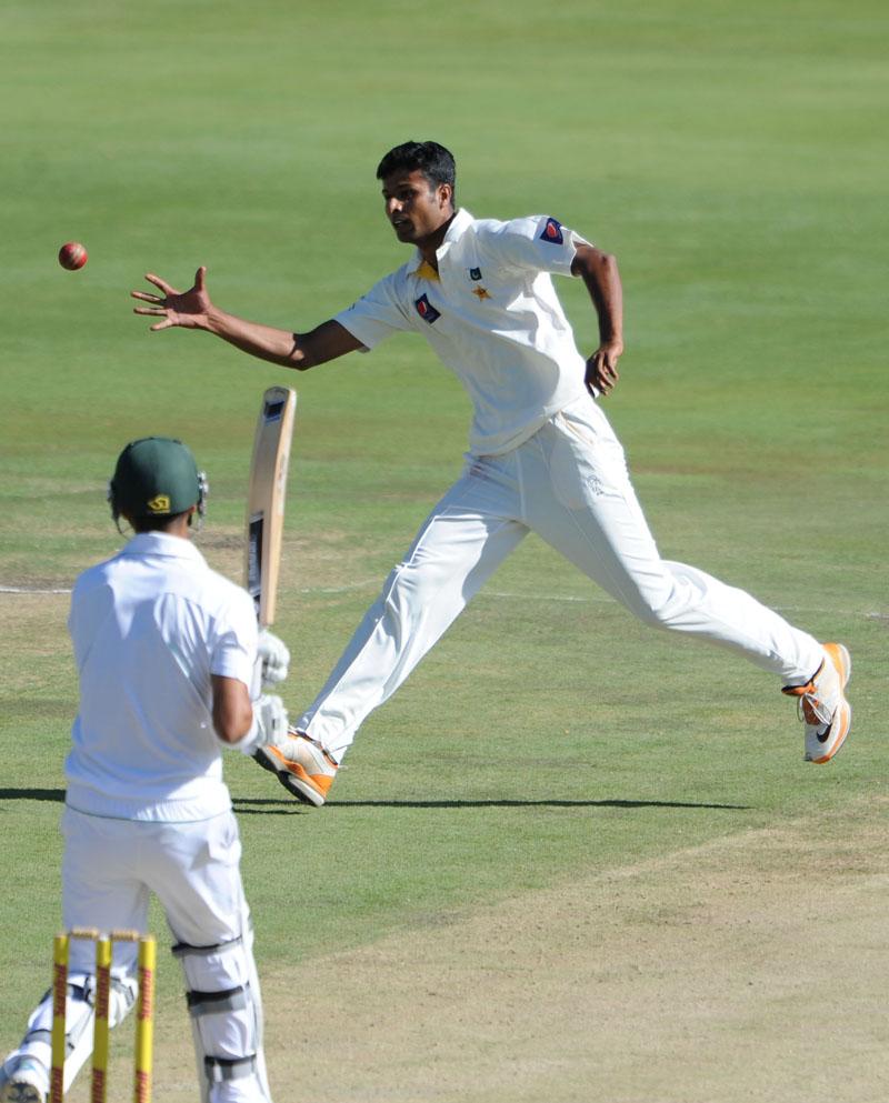 Ehsan Adil fields a ball in his follow through