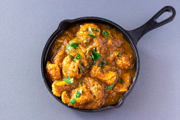 Name:  traditional-indian-butter-chicken-curry-lemon-served-iron-cast-top-view-traditional-world-cuisin.jpg Views: 42 Size:  110.3 KB